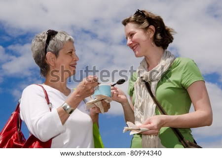 stock photo adult mother and daughter share ice cream in cup outdoors with a blue sky and white clouds for a 80994340 Alex Pettyfer IS Bringing Sexy Back. Alex Pettyfer IS Bringing Sexy Back