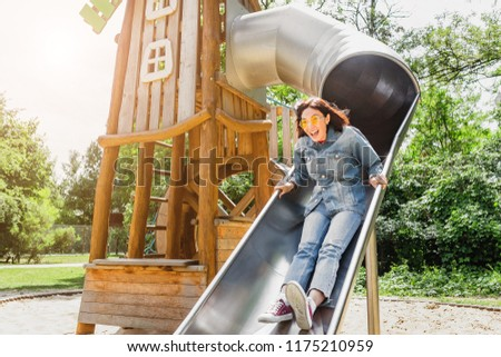 Adult or teenager girl having fun on playground