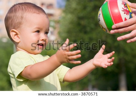 Adult pass ball to boy
