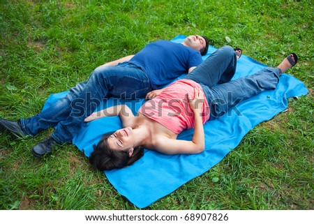 Adult pregnant couple spending time in nature