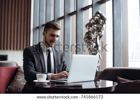 Adult serious man has business conversations using on-line mobile application. Developer innovational business web applications in the internet. Stylish guy. Business portrait. Cloud technologies. #741866173