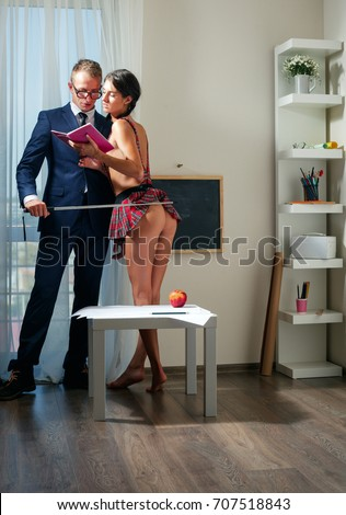 Boss undressing secretary in office, lovers Images and Stock Photos