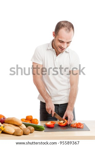 Adult smiling man cooking in the kitchen