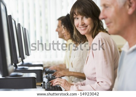 stock photo : Adult students in a computer lab