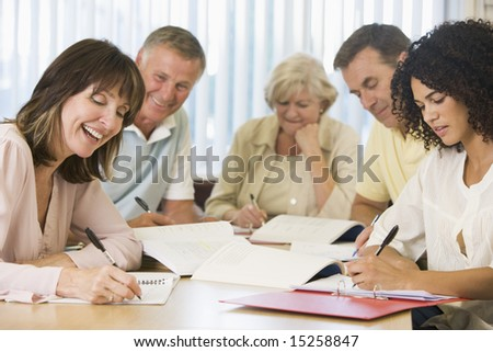 Adult students studying together - stock photo
