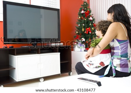 Adult Woman and Child Watching TV .