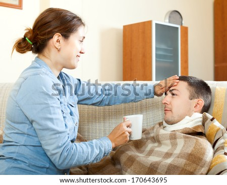 Adult woman caring for sick man