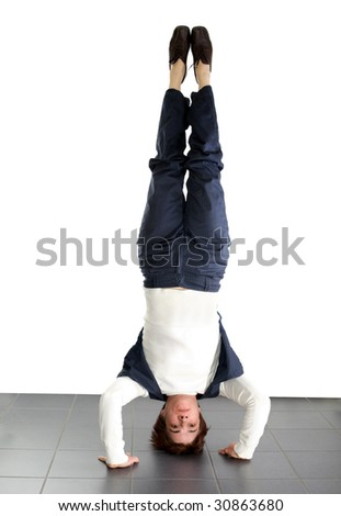 adult woman doing a headstand