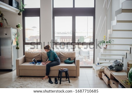 Adult woman indoor at home smart working using computer - working from home, business, remote working concept