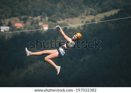 Adult woman on zip line
