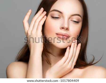 Adult woman portrait, skin care concept, beautiful skin and hands with manicure nails. Studio shot.