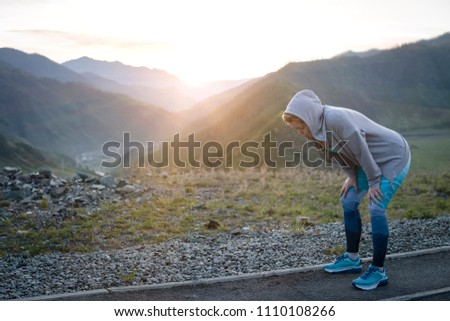 Adult woman resting after running. Sports and recreation #1110108266