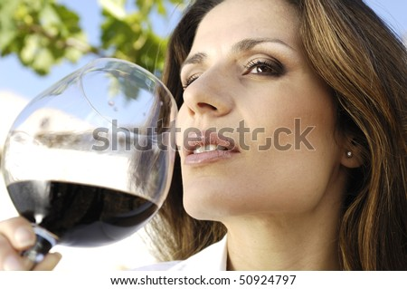 Adult woman smelling wine