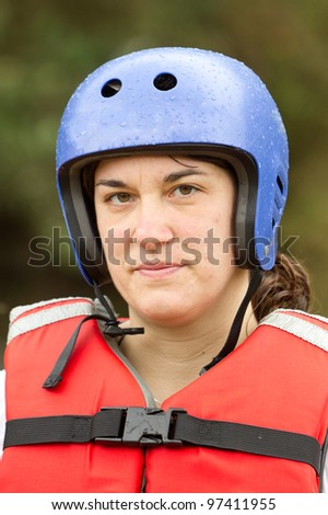 stock photo : Adult woman wearing typical water sport outfit