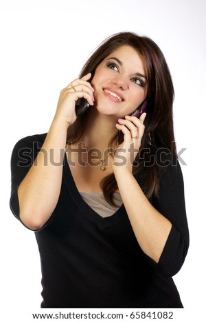 Adult young lady talking on two mobile phones at the same time.