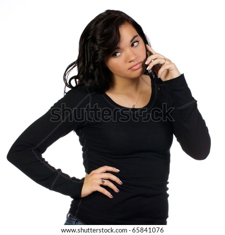 Adult young lady with look of disgust from what she is hearing on her mobile phone.