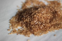 Adulterated Kerala red rice mixed with cheaper white rice. Kerala red rice is also known as matta rice.