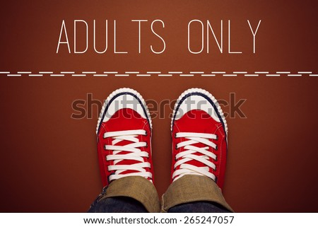 Adults Only Concept, Young Teenage Person in Red Sneakers Standing at Dividing Line of Restricted Area, top view