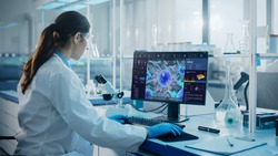 Advanced Medical Science Laboratory: Medical Scientist Working on Personal Computer with Screen Showing Virus Analysis Software User Interface. Scientists Developing Vaccine, Drugs and Antibiotics.