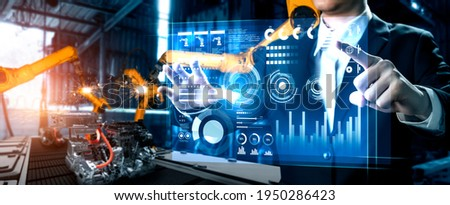 Advanced robot arm system for digital industry and factory robotic technology . Automation manufacturing robot controlled by industry engineering using IOT software connected to internet network . Foto stock ©