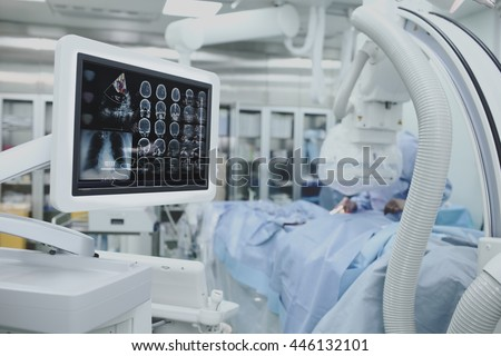 Advanced technology, collection of patient tests on the monitor during surgery.