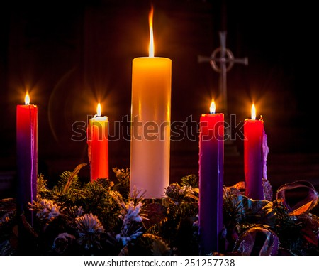 Advent candles glow and mark the celebration of Christmas/Advent Wreath