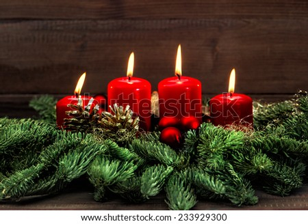 advent decoration with four red burning candles. holidays background. selective focus, vintage style toned picture #233929300