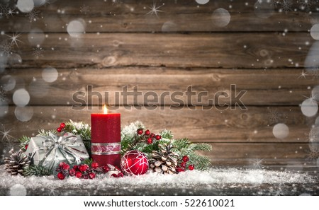 Advent decoration with one burning candle on wooden board. Christmas background