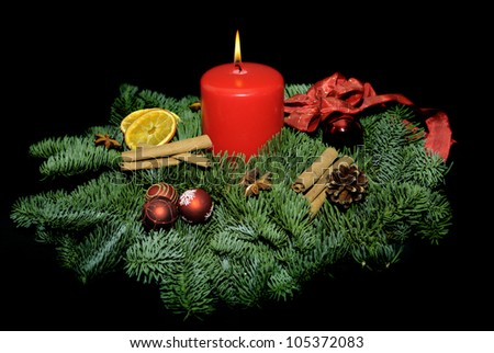 Advent wreath with candle and decorations