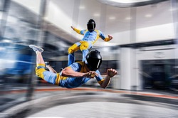 Adventure activity fly in Dubai. Indoor sky diving trick. Action fly sport activity in wind tunnel