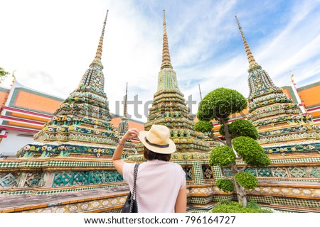 Adventure Asian beautiful tourist women travel in the buddha temple back view in Bangkok Thailand #796164727