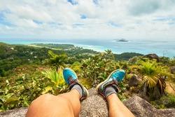 Adventure man hiking on chenard mountain, praslin, seychelles