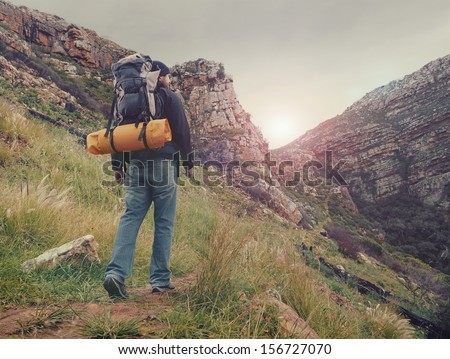 Shutterstock Adventure man hiking wilderness mountain with backpack, outdoor lifestyle survival vacation