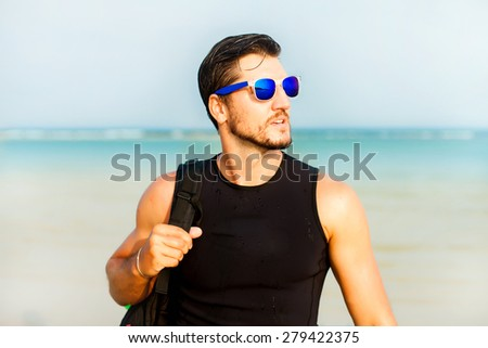 Adventure man hiking wilderness serf with backpack, outdoor lifestyle survival vacation,Portrait of bearded man with sunglasses,travel bag and reflecting sunglasses,behind the ocean view