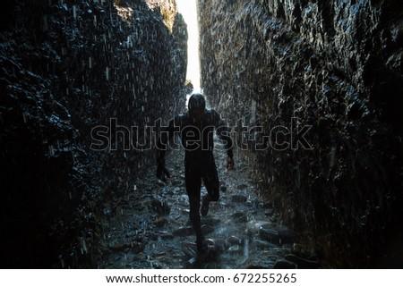 Adventure seeking cave exploring.