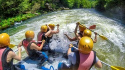 adventure team doing rafting on the cold waters of the Nestos River in Paranesti, Greece. Nestos river is one of the most popular among rafters in Greece