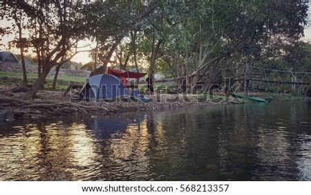 adventure travel camping tent in the   wood  forest upstream lake with  sunset   Remote Relax Concept