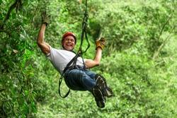 adventure zip line zipline sport man forest tree people adrenaline men grown male on zipline ecuadorian andes adventure zip line zipline sport man forest tree people adrenaline men tour courage fast r