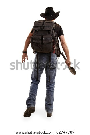 Adventurer explorer with spade view from back - stock photo