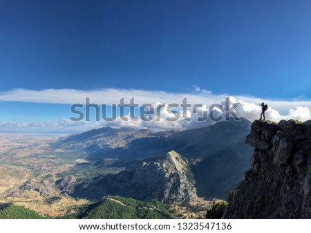 adventurer man on the cliff and success #1323547136