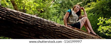 Adventurer Resting on a Log