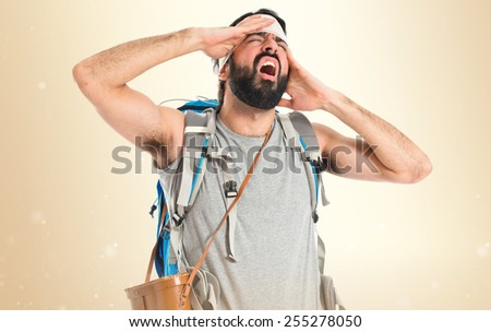 Adventurer with head injury over ocher background