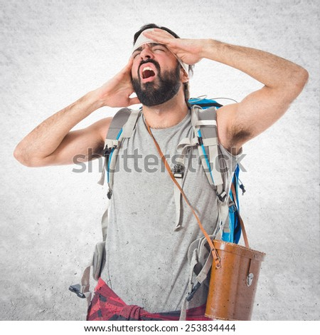 Adventurer with head injury over textured background