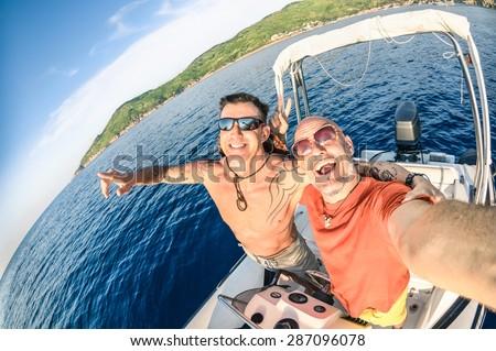 Adventurous best friends taking selfie at Giglio Island on luxury speedboat - Adventure travel lifestyle enjoying happy fun moment - Trip together around the world beauties - Fisheye lens distortion