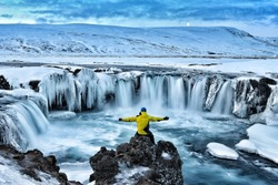 Adventurous man at Godafoss on Iceland