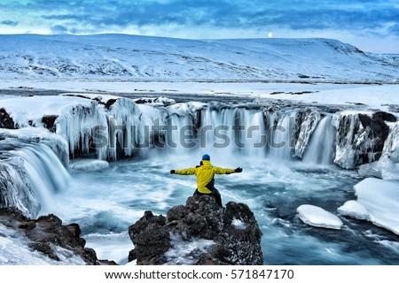 Adventurous man at Godafoss on Iceland