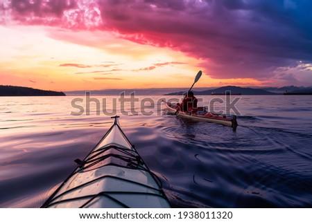 Adventurous Man Sea Kayaking in the Pacific Ocean. Dramatic Colorful Sky Art Render. Taken in Jericho, Vancouver, British Columbia, Canada. Stok fotoğraf ©