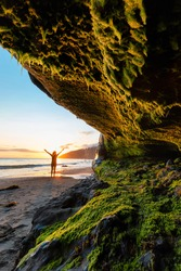 Adventurous Woman at Mystic Beach on the West Coast of Pacific Ocean. Summer Sunny Sunset. Canadian Nature Landscape Background. Located near Victoria, Vancouver Island, British Columbia, Canada.