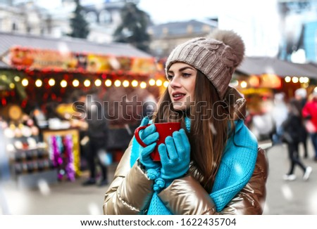 advertisement, beautiful, beverage, candy, candy cane, candy cane stick, caucasian, celebration, cheerful, christmas, cup, decoration, drink, emotions, european, fair, female, festival, girl, gloves,
