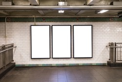 advertisement billboards electronic displays in a subway station in New York City